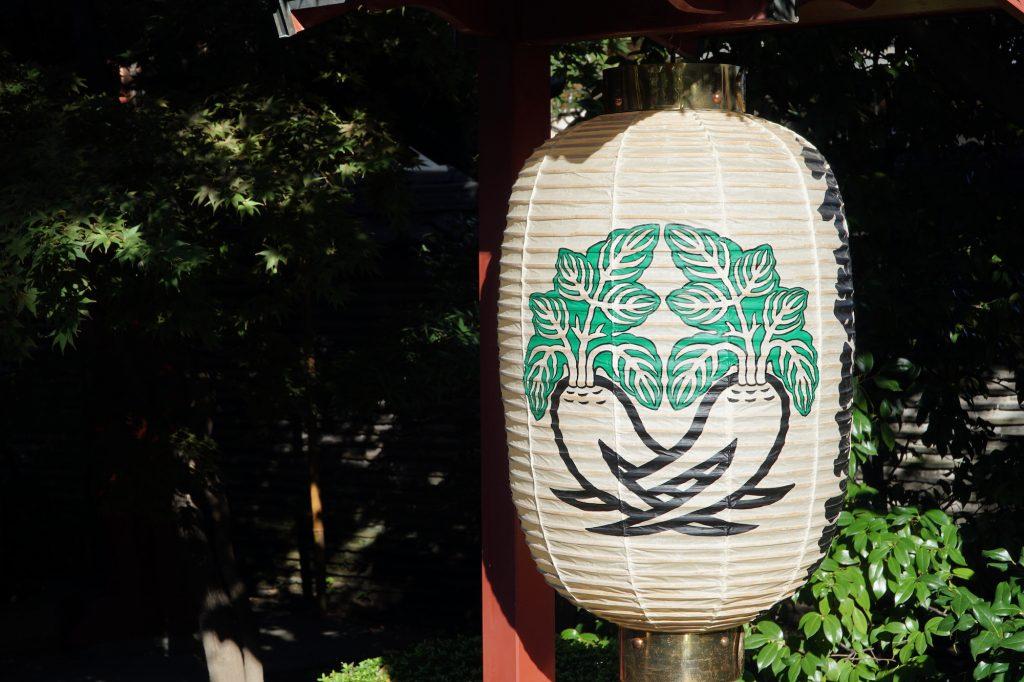 Lantern with Daikon ornament at Matsuchiyama Shoden Temple, Asakusa, Tokyo. © touristinjapan.com